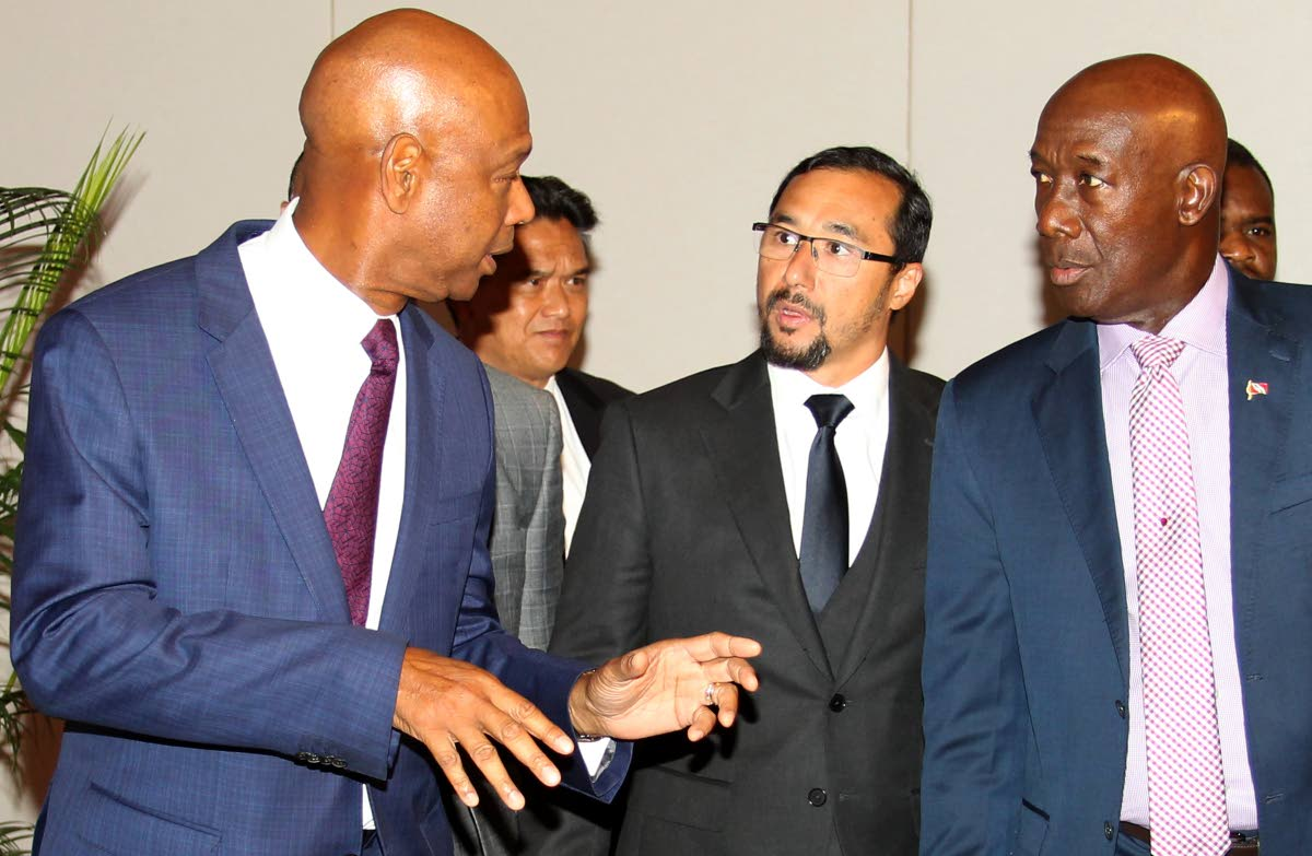 SHELL SHOCKED: Whatever outgoing Shell vice president and country chairman Derek Hudson was saying, he had the undivided attention of Prime Minister Dr Keith Rowley and National Security Minister Stuart Young yesterday at the NGC Shell term sheet signing at the Hyatt Regency in Port of Spain.