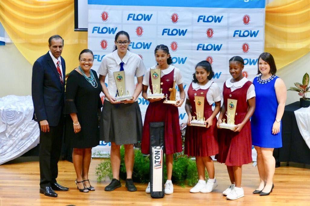 President of the SSCL Surujdath Mahabir, from left, Cindy Ann Gatt of Flow, Jesse Ferdinand,  Shunelle Sawh, Azariyah Ali, Sydney Broomes and Jacinta Pinard-Thompson of Flow.