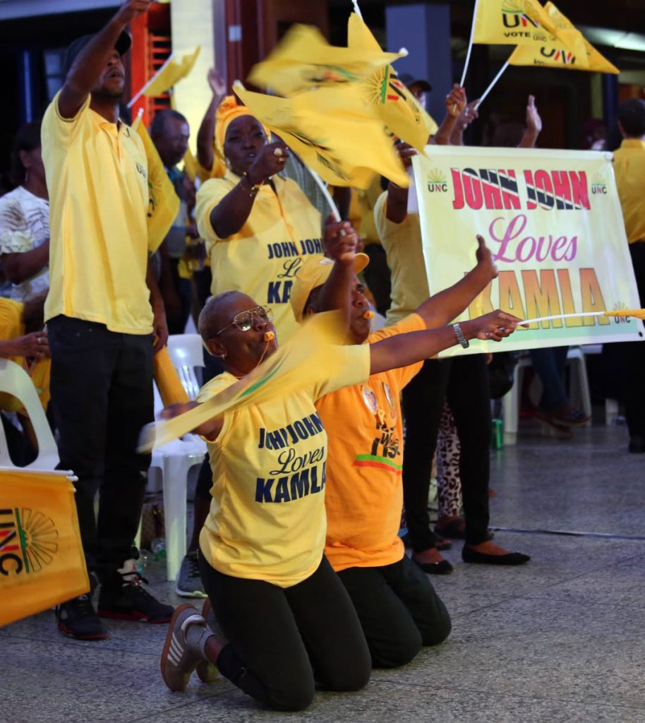 ON BENDED KNEES: UNC supporters go on bended knees to show their support for political leader Kamla Persad-Bissessar during the party's Monday Night Forum in San Juan.  PHOTO BY SUREASH CHOLAI