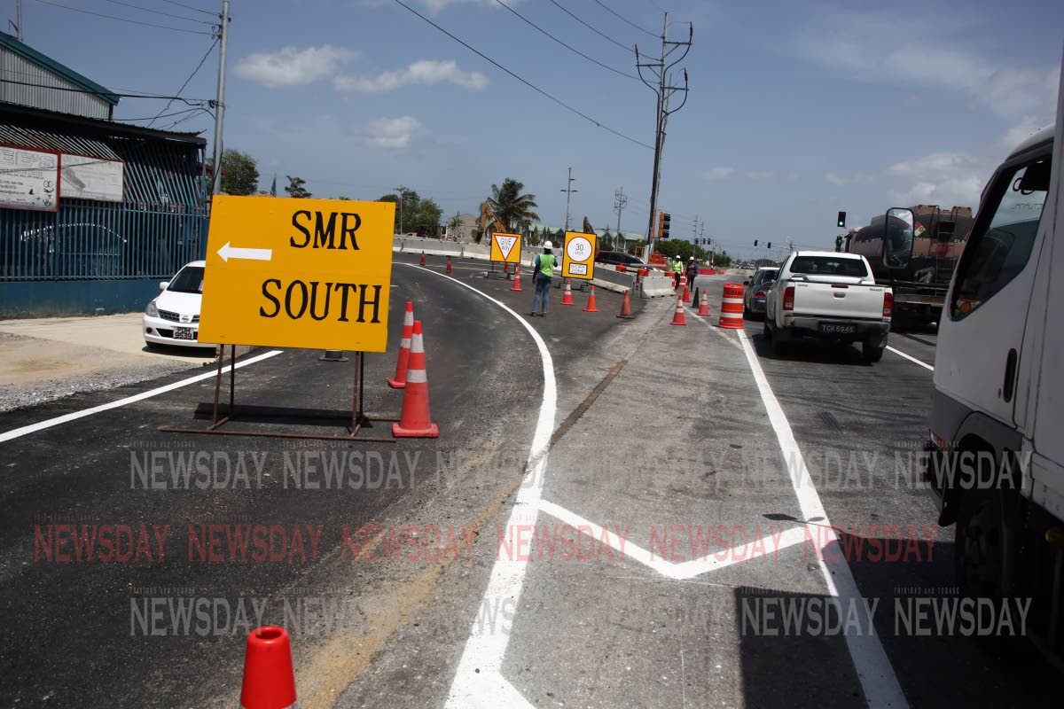 Motorists ease into the new traffic flow of the Southern Main Road in the vicinity of the Curepe Intersection, Churchill Roosevelt Highway. PHOTO SUREASH CHOLAI