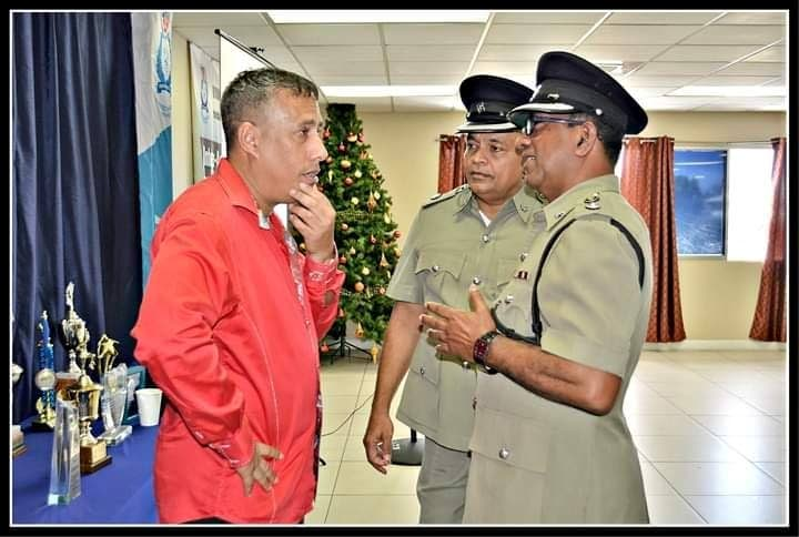 Commissioner of Police Gary Griffith, left, speaks to Snr Supt Simboondath Rajkumar (closest to camera) and Supt Wayne Mohammed during an event at the IATF headquarters, El Socorro, last Christmas.    PHOTO COURTESY TTPS