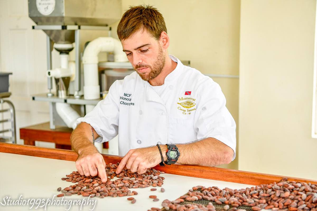 James Burns, owner of local chocolate brand JB Chocolates, is very meticulous when it comes to sorting cocoa beans. Photo courtesy JB Chocolates