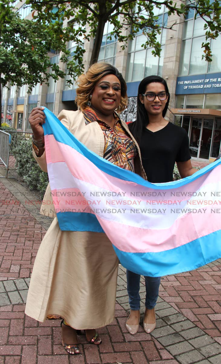 President of the Trans Alliance Brandy Rodriguez and Shannon Sirju outside parliament. PHOTO BY AYANNA KINSALE