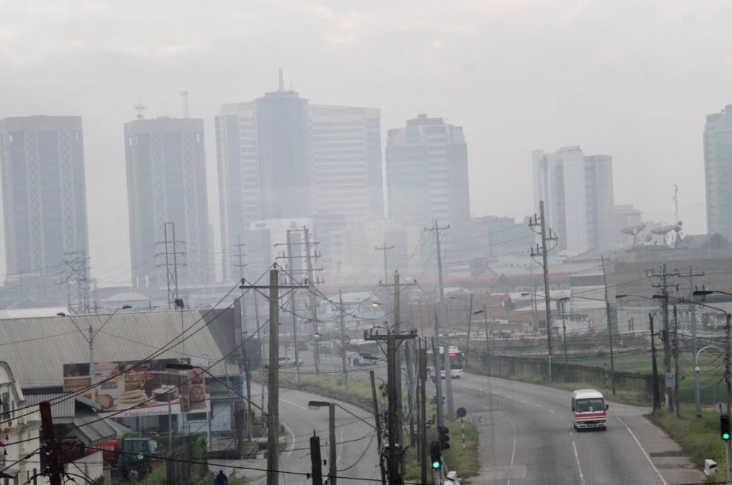 In this February 23, 2016 file photo smoke from a fire at the Beetham landfill hovers over Port of Spain. PHOTO BY SUREASH CHOLAI