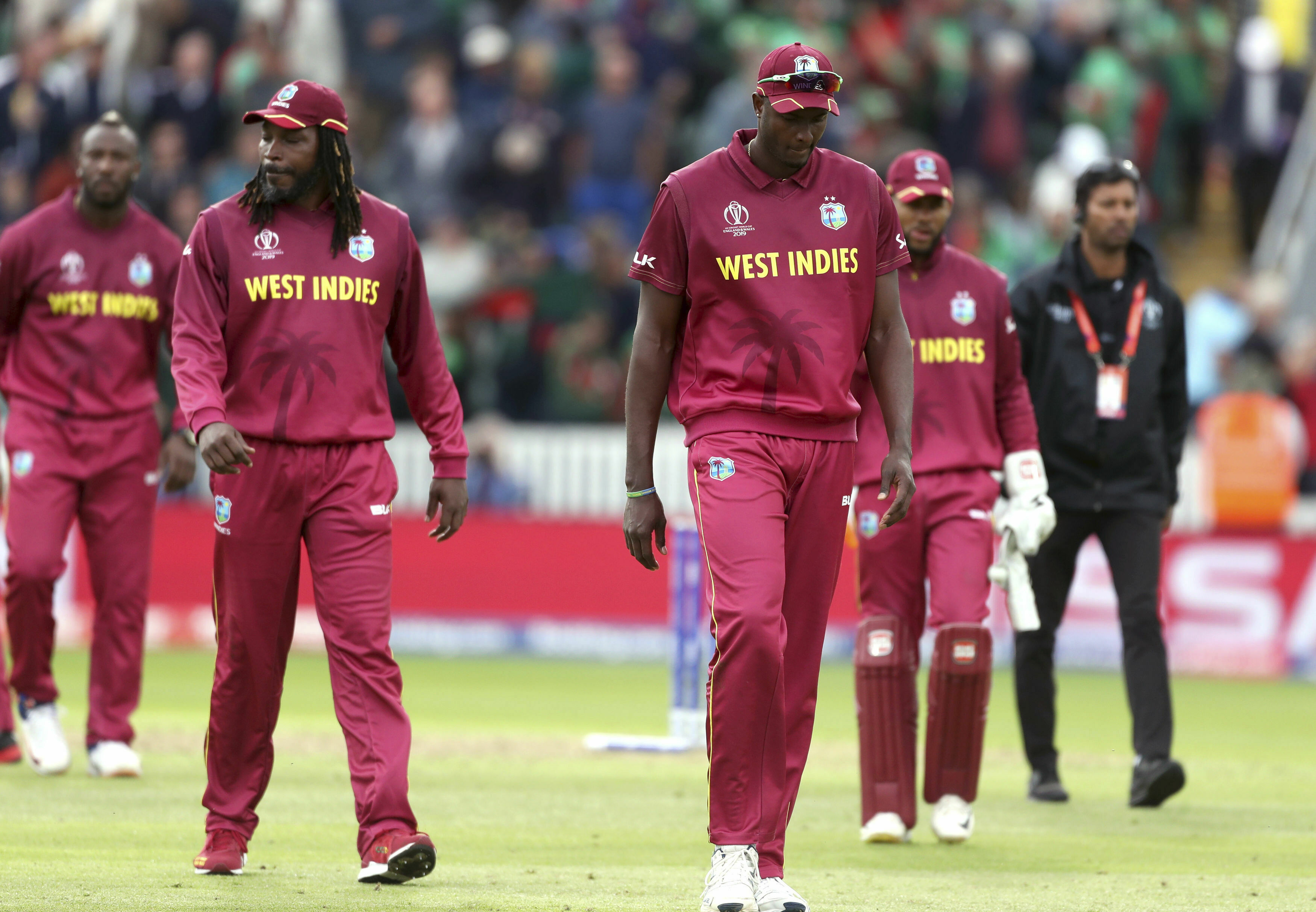 West Indies players walk off dejected after losing the Cricket World Cup match between West Indies and Bangladesh at The Taunton County Ground, Taunton, south west England, Monday June 17, 2019. (David Davies/PA via AP)