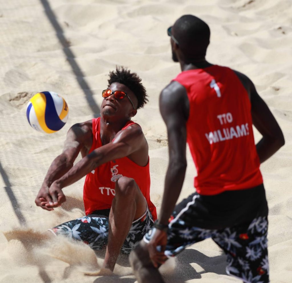 Team TTO's Men's Beach Volleyball team (Red shirt, Black shorts), Daneil Williams (#1) and Daynte Stewart (#2) Photo: Allan V. Crane