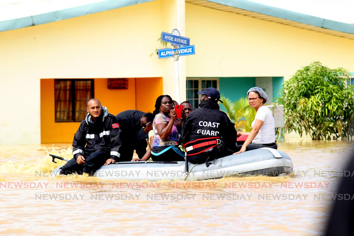Coast Guard teams rescue residents from HDC's Greenvale Park, La Horquetta, after flooding to torrential rainfall on October 20, 2018. FILE PHOTO: LINCOLN HOLDER