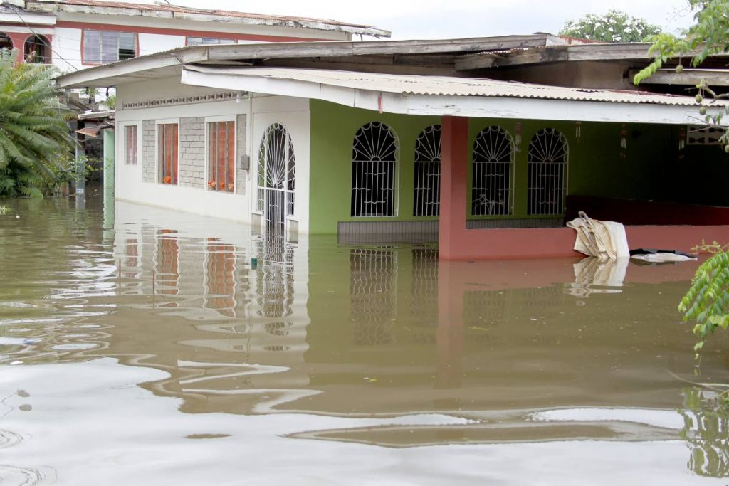 A flood scene in El Socorro in October last year. Government says it has commissioned a national drainage study to so as to be guided on flood alleviation plans. FILE PHOTO