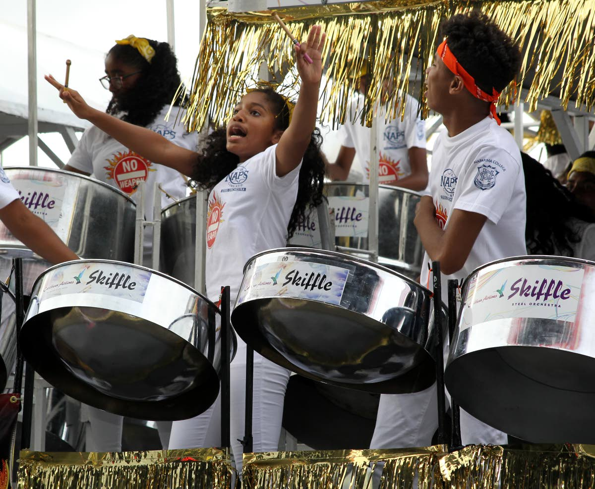 Students of Naparima College and Naparima Girls' High School perform together as Naparima Combined Steel Orchestra to win the secondary schools category of junior Panorama on February 24. FILE PHOTO