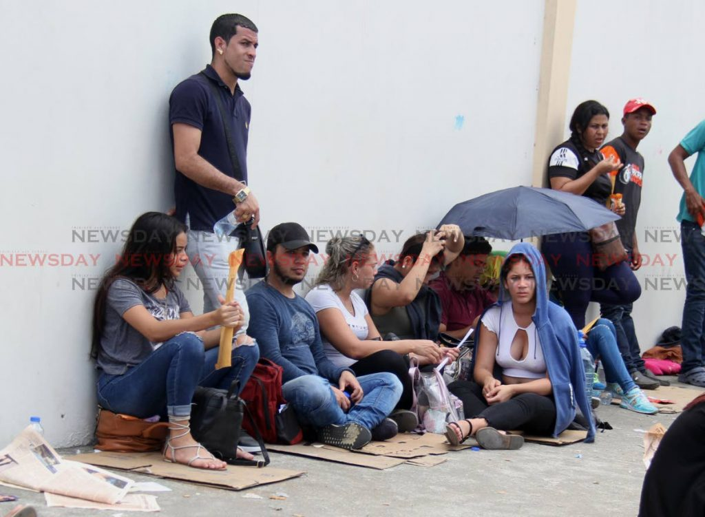 File photo: In this June  2019 photo, Venezuelan women and men wait to register at Queen's Park Oval, Port of Spain.PHOTO BY AYANNA KINSALE