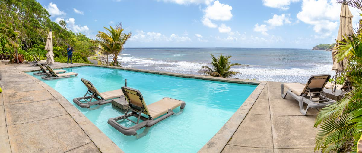 The pool overlooking the ocean at Pagua Bay guesthouse and restaurant in Dominica. Photo by Jeff K Mayers