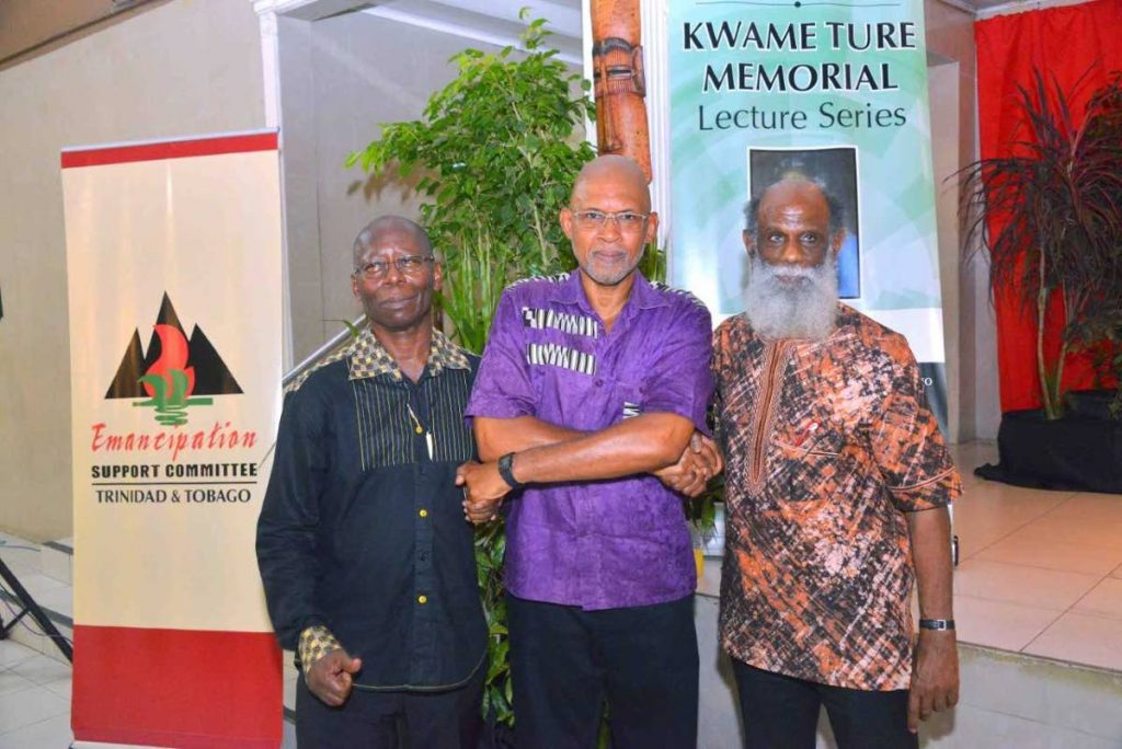 Archaeologist and cultural historian Dr Anthony Browder, centre, with Emancipation Support Committee of TT's chairman Khafra Kambon, right, and director of education and research, Dr Claudius Fergus.  Browder was the guest speaker at ESCTT's launch of the Kwame Ture Memorial Lecture Series and Film Festival.