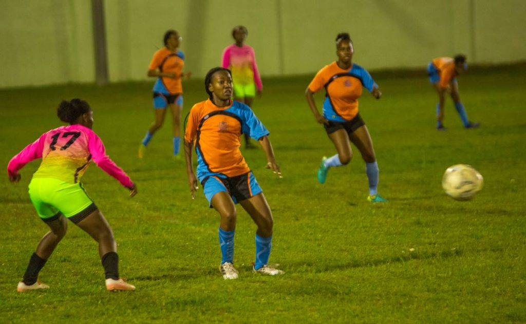 Tobago Chicas (in blue and orange) lost to Jewels FC, on Saturday, in their TT Women's Football League match, held at Black Rock,Tobago. Jewels FC won 1-0.