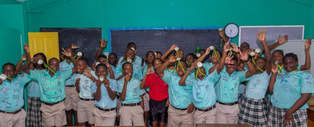 SEA students of Buccoo Government Primary School celebrate after getting their results last Friday.