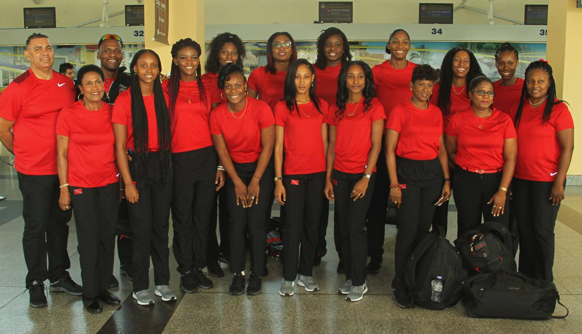 Members of the TT netball team and technical staff are all smiles prior to departing the Piarco airport yesterday for Wales for a training camp ahead of the upcoming International Netball Federation World Cup, to be held in Liverpool, England. Photo by Roger Jacob