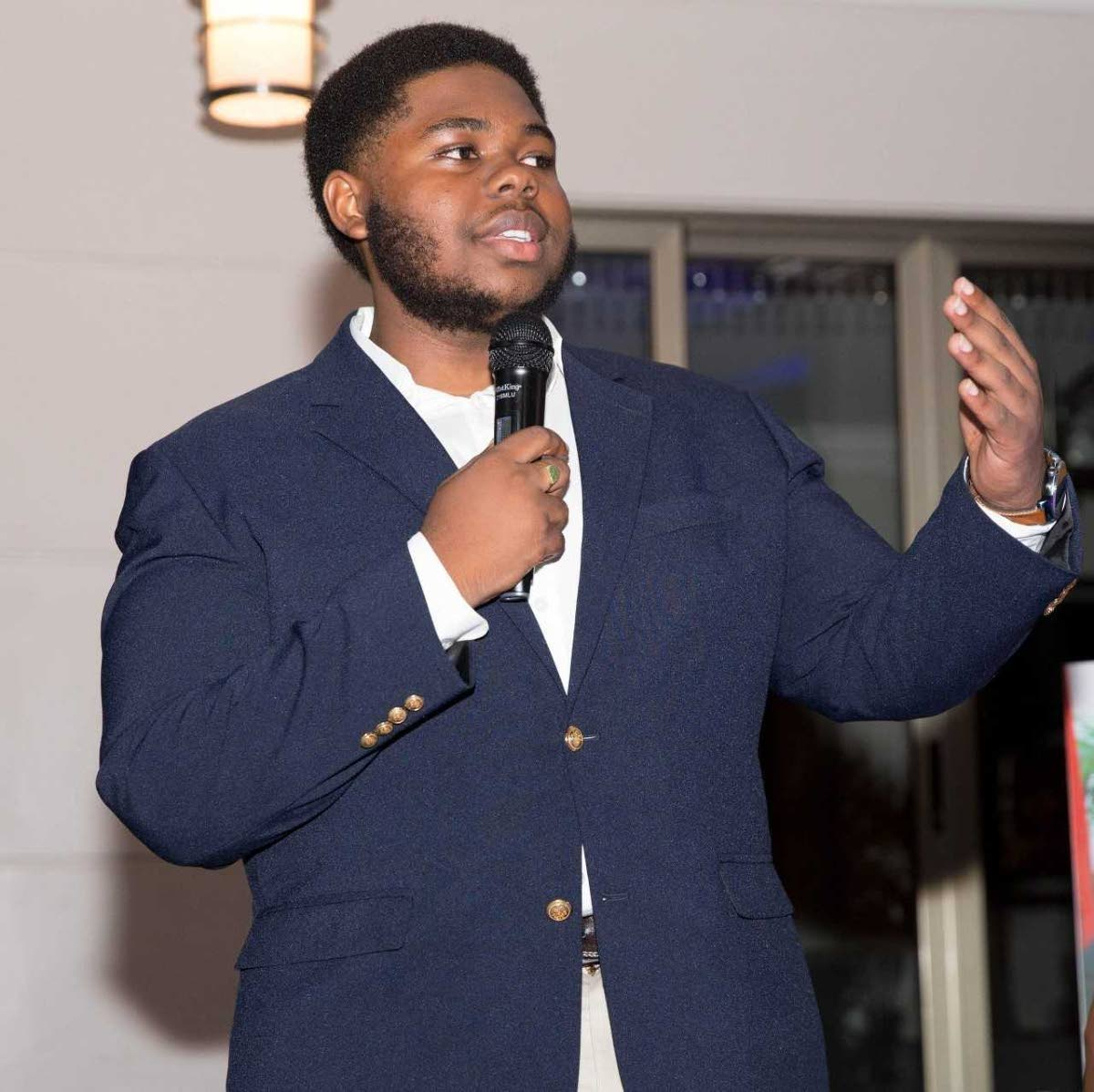 ALMA Diamond Scholar for 2018-2019 Yohance Huggins-Charles delivers acceptance remarks for the $100,000 KCV scholarship in May. He will use the funds for studies at Carleton University in Canada.