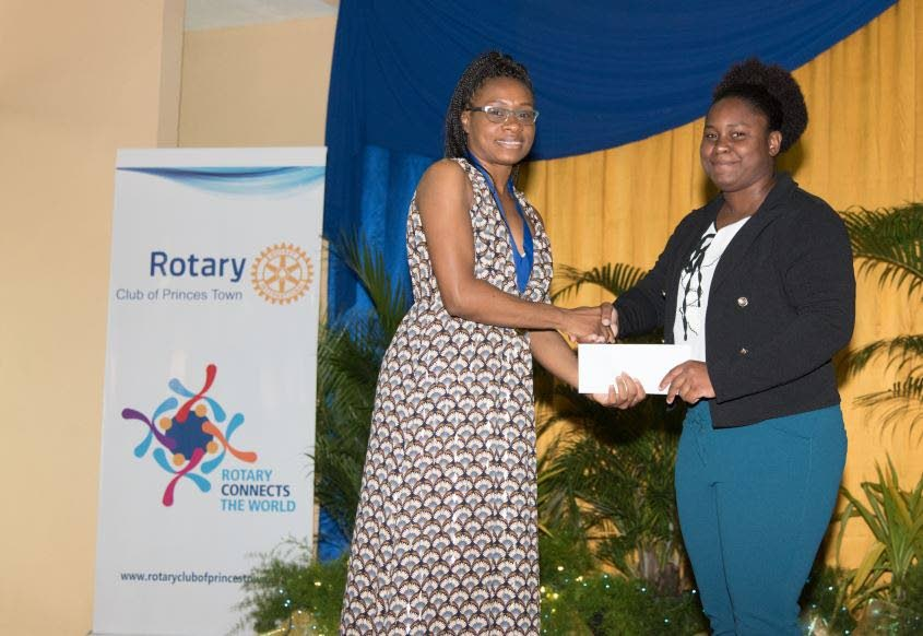 President Crystal Ann Harper presents Makeisha Simon with the $10,000 cheque. Photo courtesy Ryan Soodwah photography