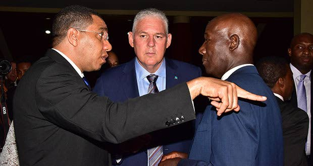 Jamaican Prime Minister Andrew Holness, St Lucian Prime Minister Allen Chastanet, and Prime Minister of Trinidad, Dr Keith Rowley, in discussion after the opening ceremony of the 37th Meeting of the Conference of Heads of Government of Caricom last Monday. (Adrian Narine photo)