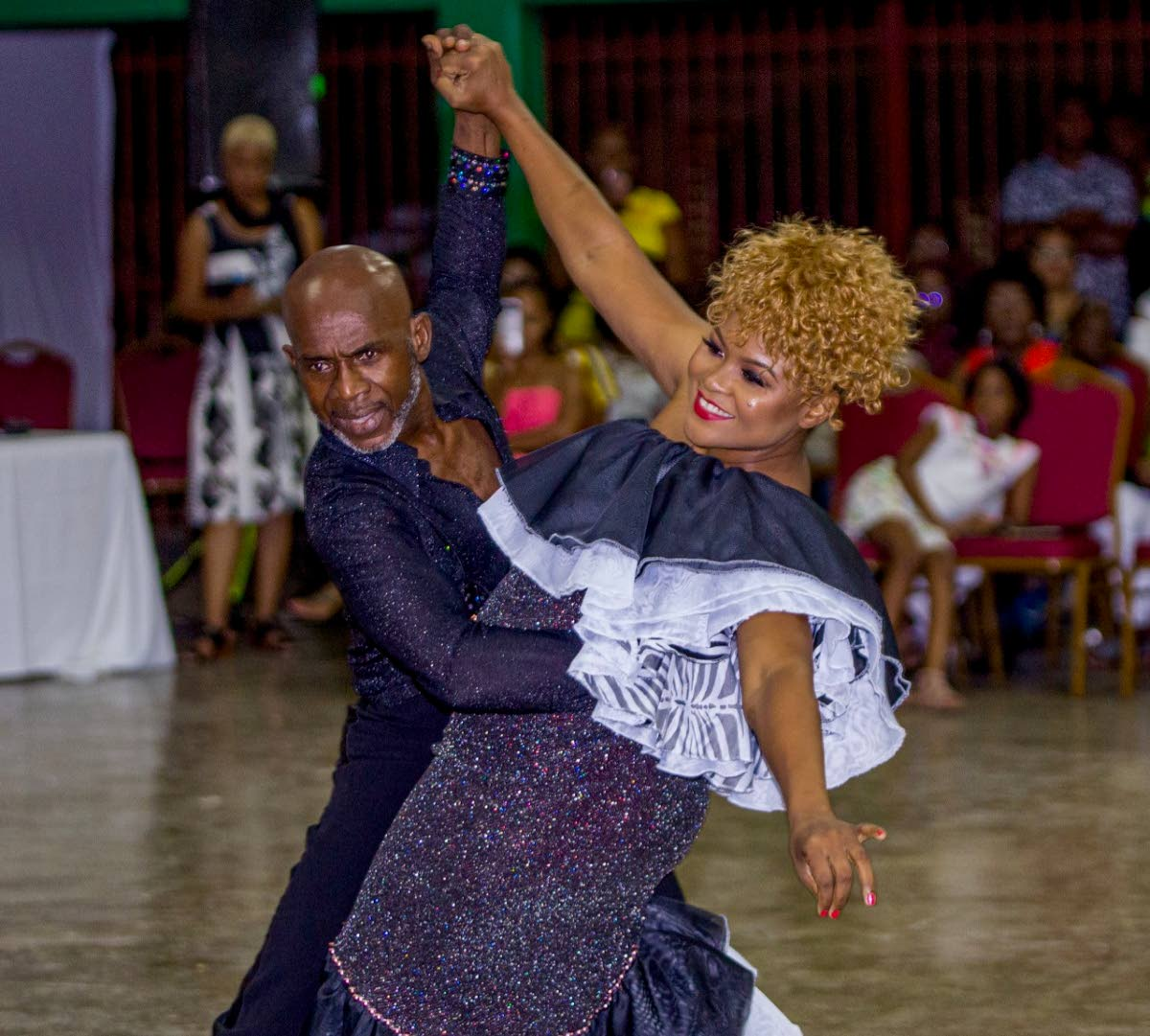 Culture Minister Dr Nyan Gadsby-Dolly, right, on her way to victory in the 2019 Dancing with Caribbean Stars competition, alongside her partner Francis Stanislaus, at the Signal Hill Secondary School on Saturday.  PHOTO BY DAVID REID