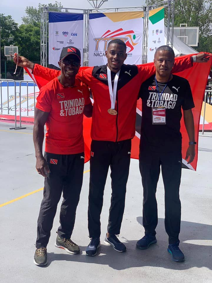 TT long jumper Andwuelle Wright, centre, celebrates NACAC U-23 gold with coach Wendell Williams, left, and NAAA official Dexter Voisin in Mexico last Friday. PHOTO COURTESY DEXTER VOISIN FACEBOOK PAGE