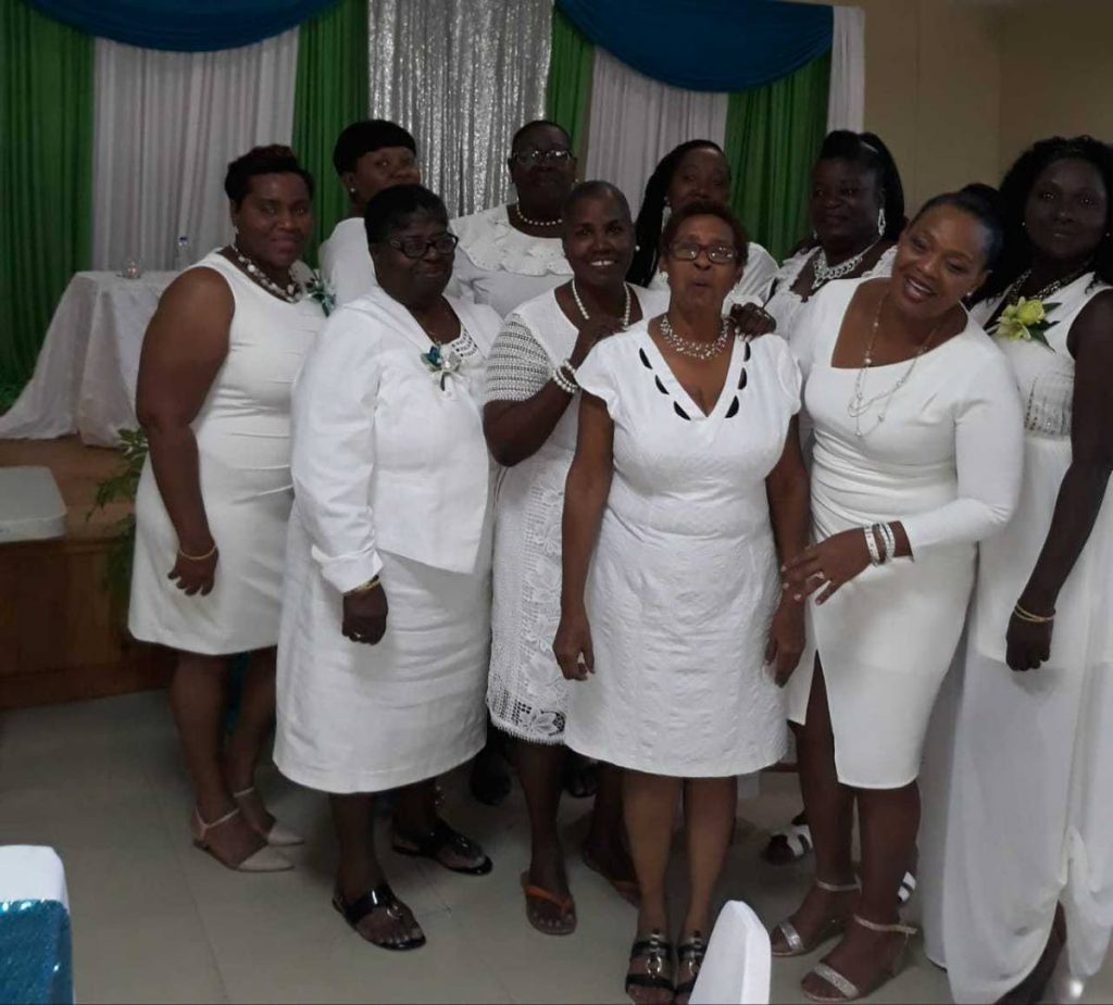 President of the TT Federation of Women's Institute Irene Hinds (second from left - middle row) and other members at the organisation's 73rd annual conference at Canaan/Bon Accord community centre, Tobago. PHOTO COURTESY TT FEDERATION OF WOMEN