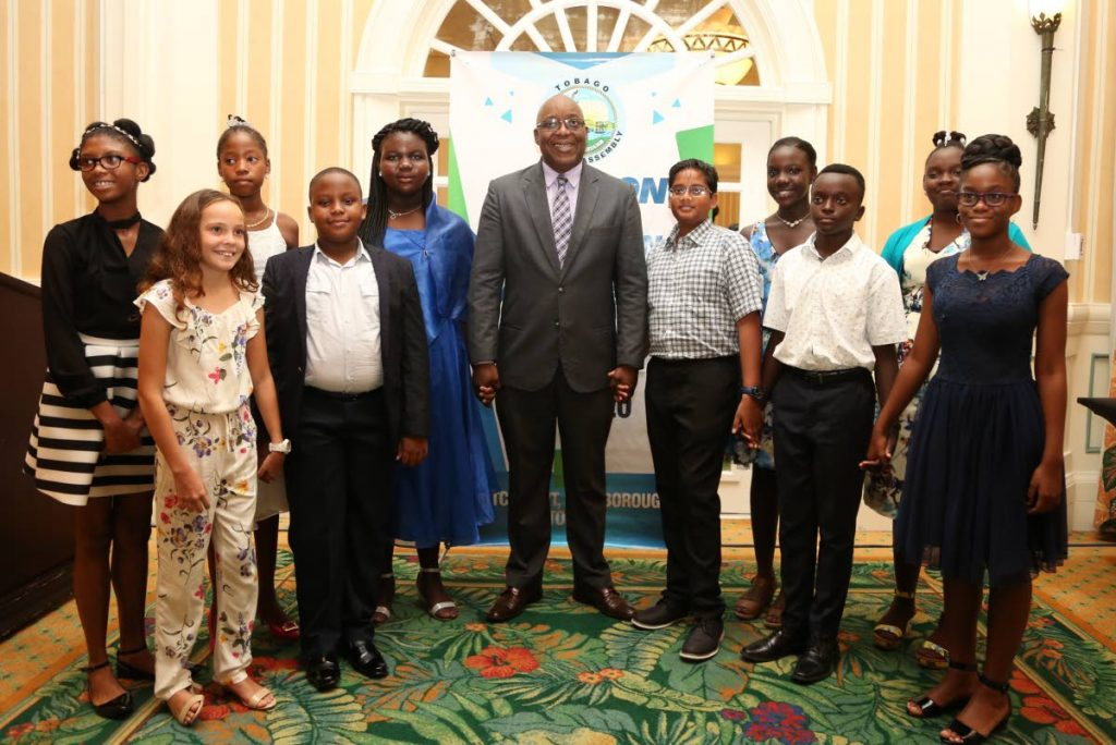 Chief Secretary Hon. Kelvin Charles (C) is flanked by the Top 10 SEA Students in Tobago. L-R back row: Brianna McPherson, Belle Garden AC; Adanna Rodriquez, Buccoo Government Primary; Daniella Taylor, Bethesda Government Primary; Sebastian Rampersad, Buccoo Government Primary; Xhane Gray, Signal Hill Government Primary; Achelle Melville, Signal Hill Government Primary.  L-R front row: Jade Llanos, Private Candidate; Kaelan Bynoe, St. Nicholas Private Primary and Brandon-Mark Browne and Jaden Roberts of the Pentecostal Light & Life Foundation Primary.