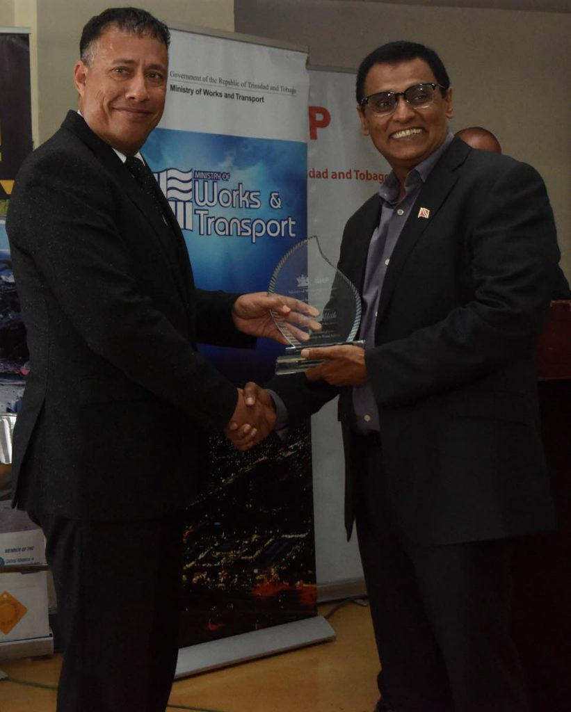 Senator Rohan Sinanan Minister of Works and Transport present Police Commissioner Gary Griffith with an award in Leadership in Road Safety during Annual Road Safety awards at Ministry of Works and Transport port of spain. Photo by Kerwin Pierre