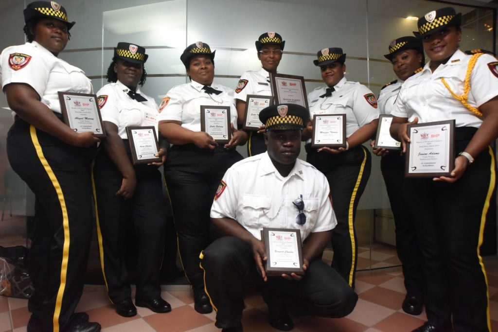 Members of the Traffic Warden Division pose with their awards at the Sixth Annual Road Safety Awards ceremony at the Ministry of Works and Transport in Port of Spain.
