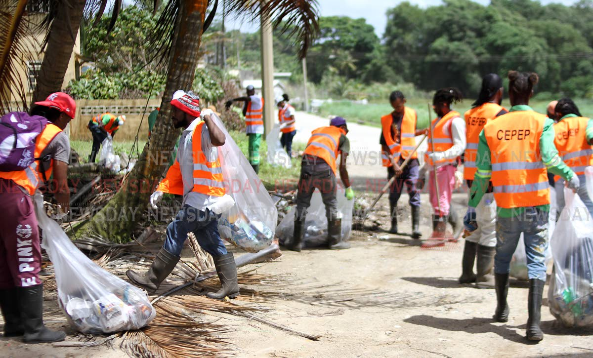 CEPEP workers clean the Manzanilla Beach as part of a coastal clean-up initiative by the organisation. Photo by Angelo Marcelle