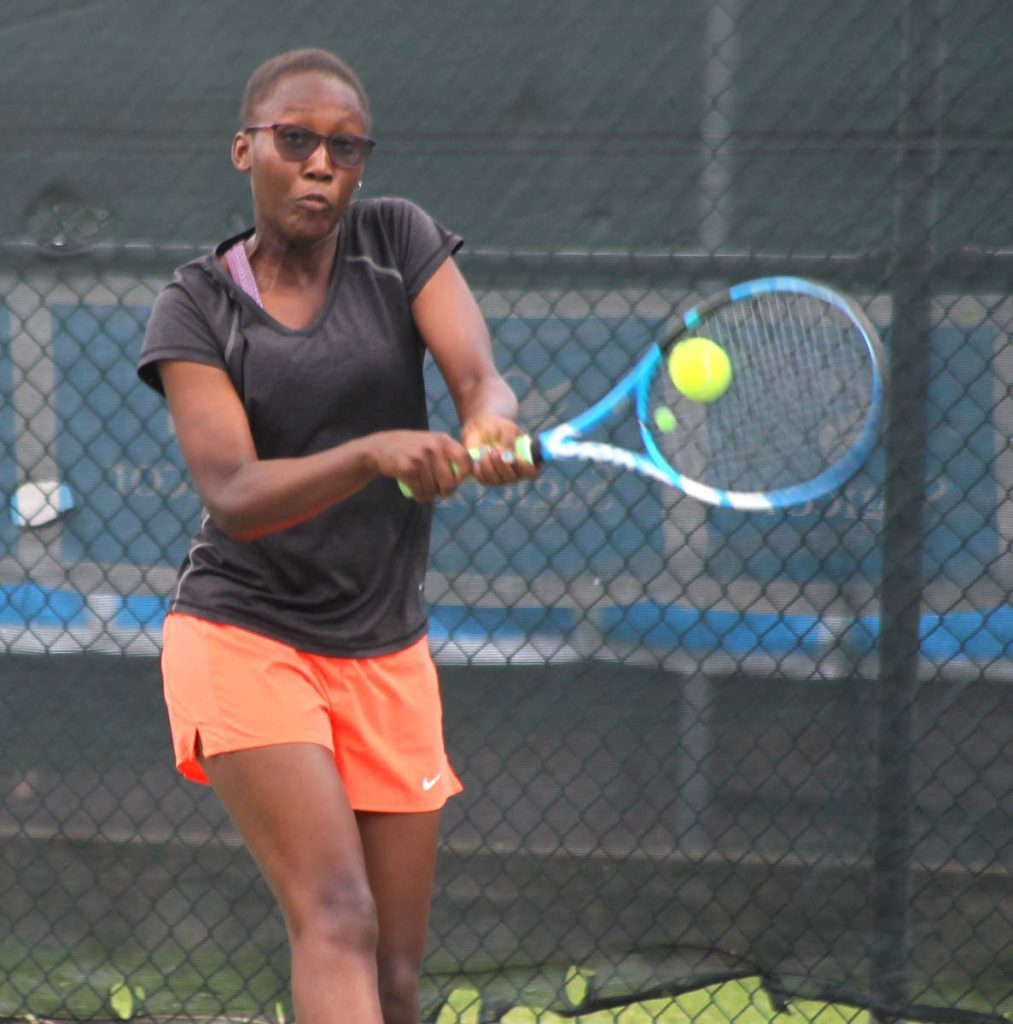 Maria Honore attempts to play a shot in the senior girls doubles final at the Sagicor Junior Tennis Tournament, Trinidad Country Club, Maraval. Honore and Chelsea Mukerji lost to Aalisha Alexis and Shauna Valentine 6-2, 6-2. Earlier in the day, Honore won the girls 16 and under singles title.