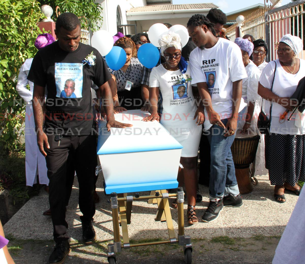 Kendel Hazel, left, and Amanda Vincent, parents of Isaiah Hazel were pall bearers at the funeral of their son at Mt. Moriah Spiritual Baptist Church, Yallery Street, Couva, on Wednesday. PHOTO BY VASHTI SINGH