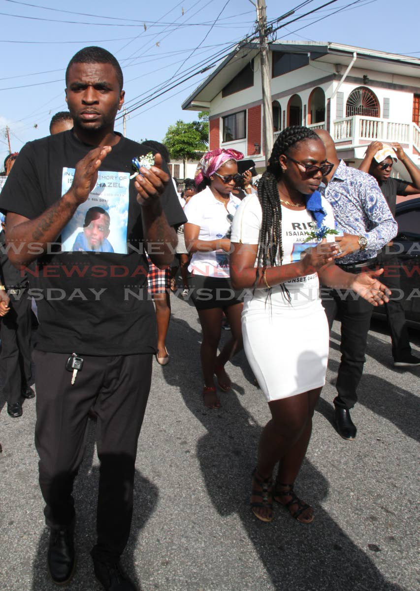 Kendel Hazel and Amanda Vincent in the funeral procession for their son Isaiah Hazel on Yallery Street, Couva on July 10. PHOTO BY VASHTI SINGH