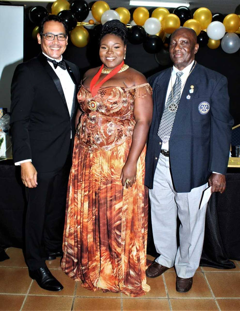 Assistant district governor Gary Williams, left, with presidents Luynda Ashby and Patrick Godson Phillip.