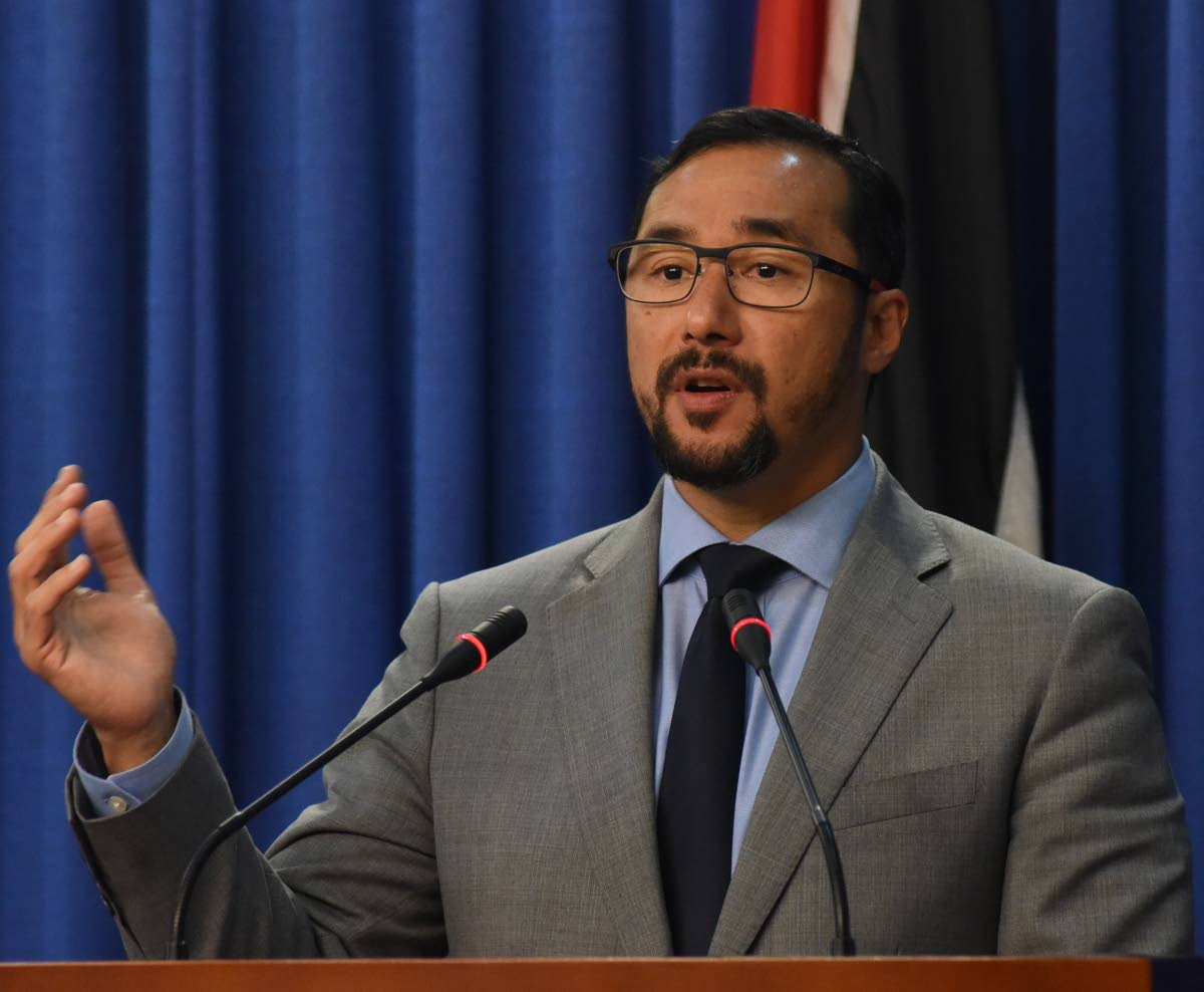 National Security Minister Stuart Young speaks to media during post-Cabinet press conference at the Diplomatic Centre, St Anns, yesterday.