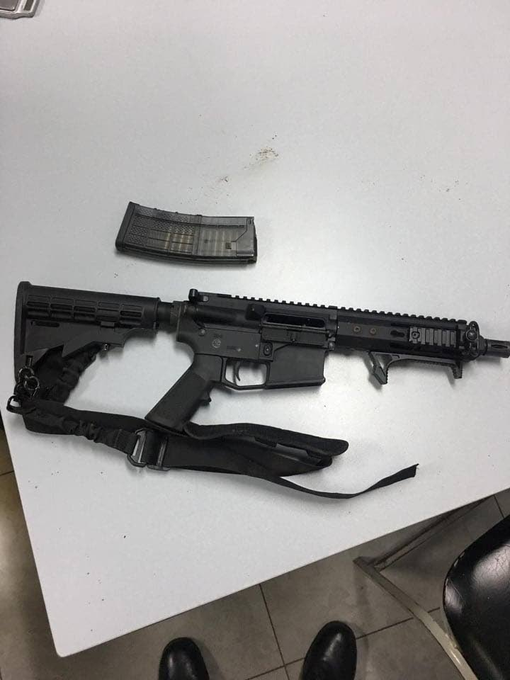 An assault rifle and magazine containing 26 rounds of ammunition were confiscated during a crime-eradication in Sea Lots this morning.  PHOTO COURTESY THE TTPS
