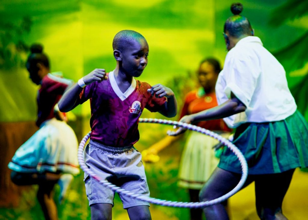 Armani Edwards of Mason Hall Folk Performers plays with a hula hoop as the group displays the games we used to play at Tobago Heritage Festival opening at Shaw Park Cultural Complex on Friday.  PHOTO BY DAVID REID