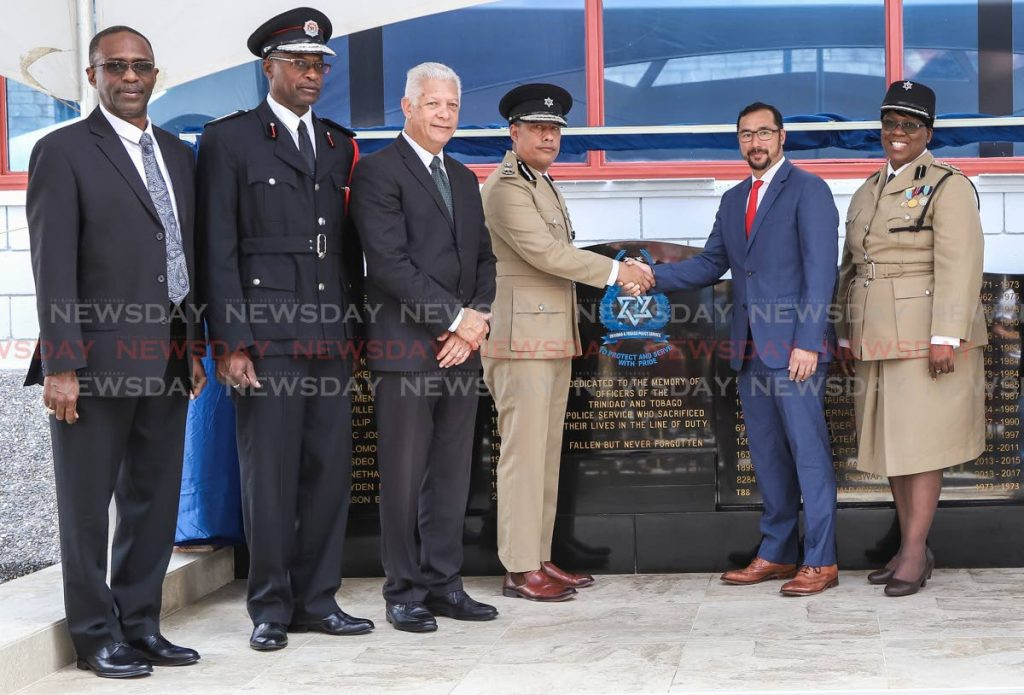 L-R DCP Harold Phillip, acting Chief Fire officer (Ag) Marlon Smith, Port of Spain Joel Martinez, CoP Gary Griffith, National Security Minister Stuart Young and acting DCP Sharon Blake-Clarke at the unveiling of memorial monument for fallen officers, Police Administration Building, Sackville Street, Port of Spain.