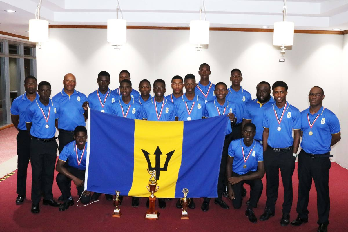 Barbados players and technical staff with their medals and trophies at the closing ceremony at the Brian Lara Cricket Academy in Tarouba, on Saturday.