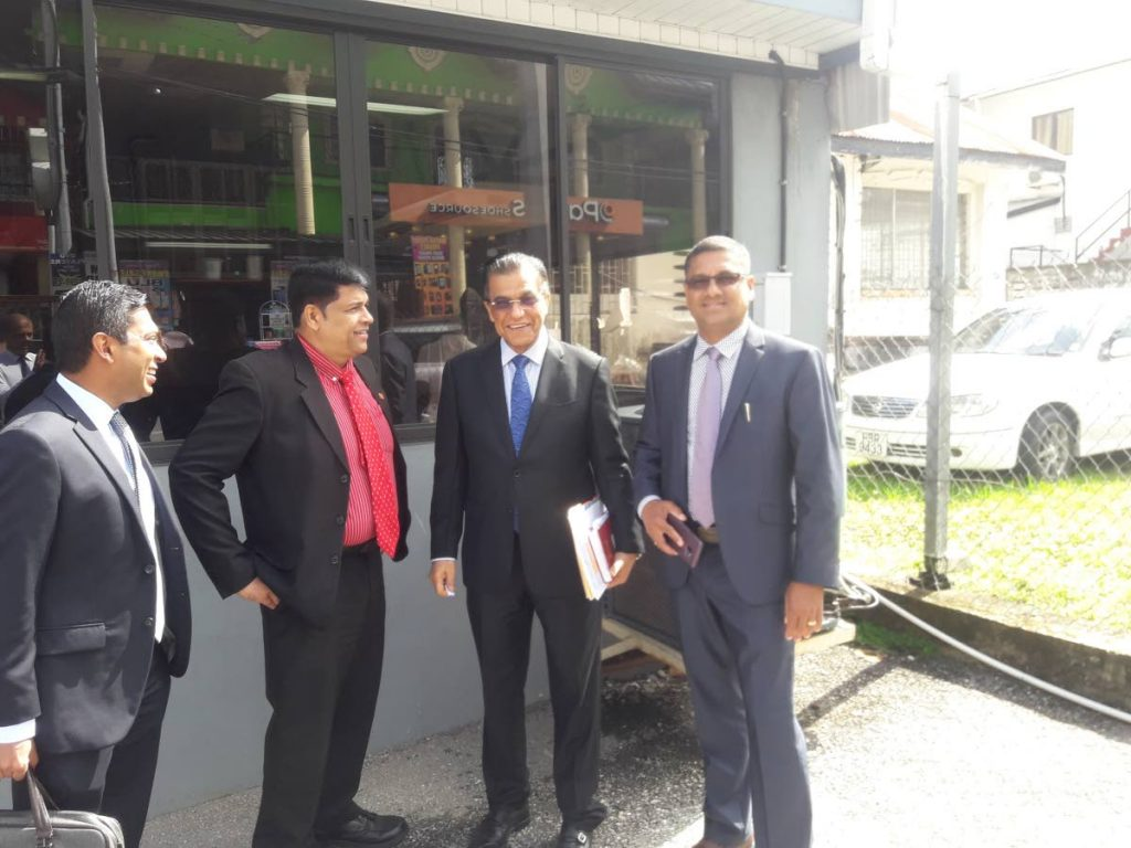 Attorneys, from left, Michael Rooplal, Prakash Ramadhar, Ramesh Lawrence Maharaj SC and Insp Billy Ramsundar outside the Siparia Magistrates Court on Monday.