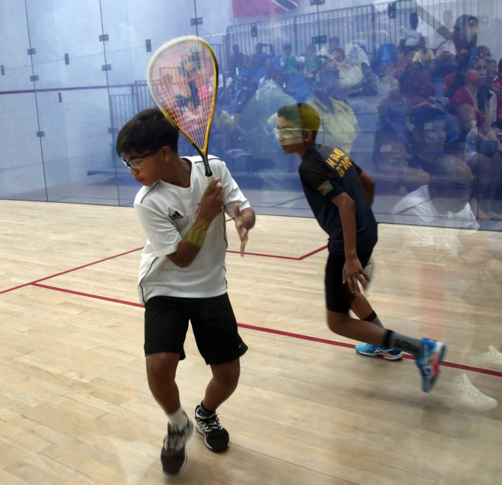TT's Seth Thong, left, plays Guyana's Mohryan Baksh in the boys Under-13 finals at the 2019 Junior Caribbean Area Squash Association (CASA) Championships at the Queen's Park Indoor Racquet Centre in St Clair, yesterday.  PHOTO BY SUREASH CHOLAI