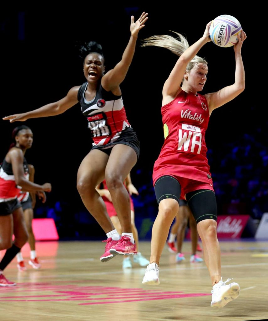 TT's Onella Jack, left, and England's Natalie Haythornthwaite in action during the Netball World Cup match at the M&S Bank Arena, in Liverpool, England, yesterday.