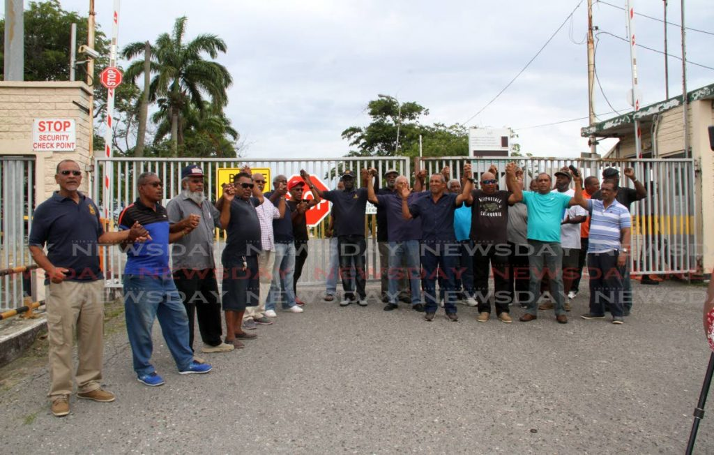 Petrotrin retirees protest at Petrotrin's Pointe-a-Pierre main administration building yesterday. PHOTO BY VASHTI SINGH