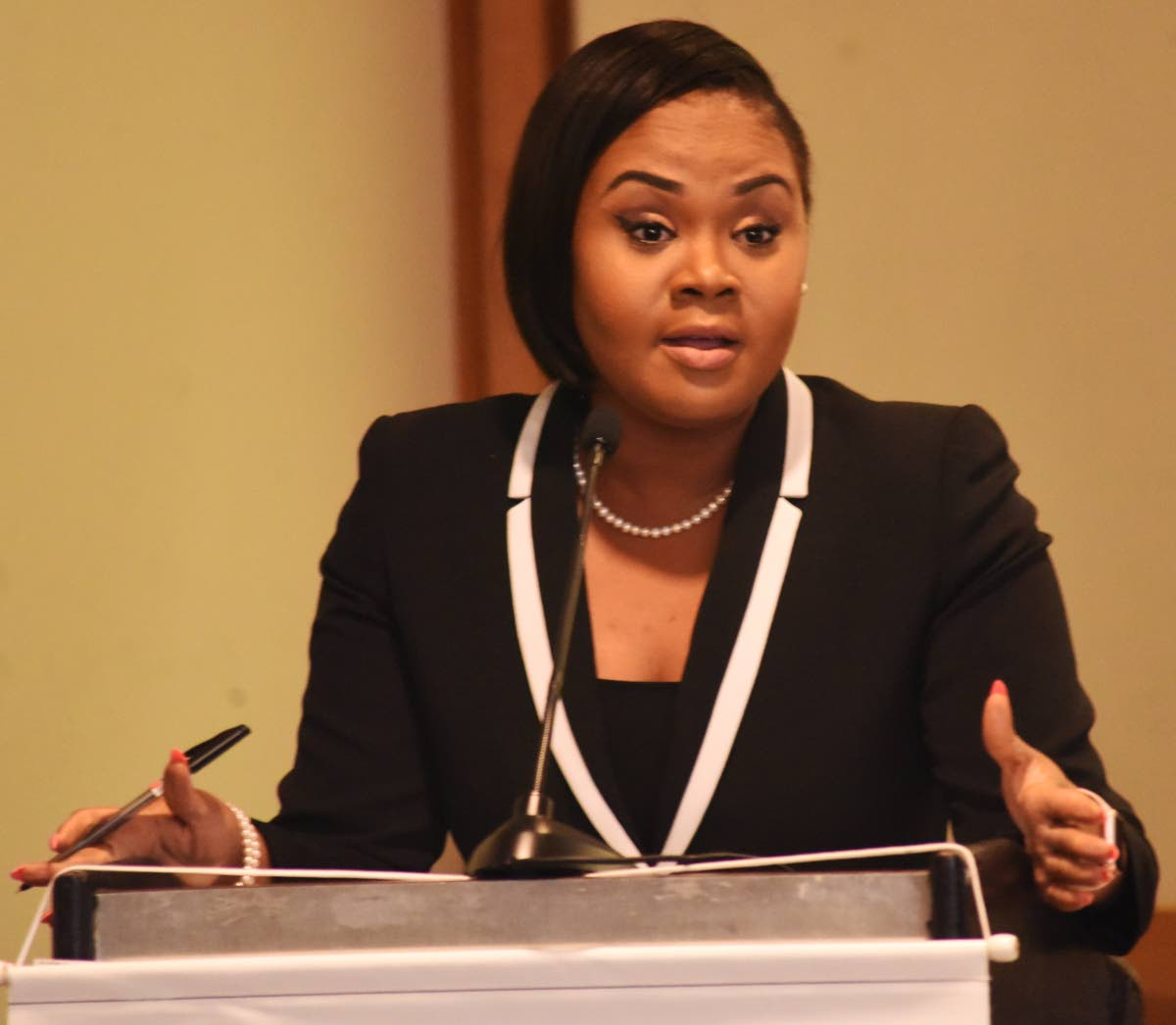 Minister of Sport and Youth Affairs Shamfa Cudjoe addresses the media during Venture Credit Union's 2019 Run + Fun Walk press conference at Hilton St Anns, yesterday.