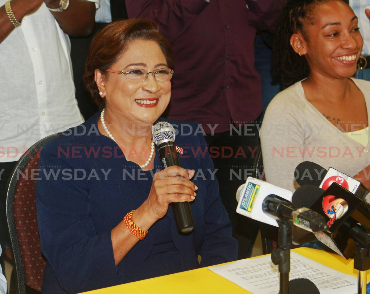 Opposition leader Kamla Persad-Bissessar, left,  speaks at a press conference at the UNC regional office in San Fernando on Wednesday. PHOTO BY: CHEQUANA WHEELER