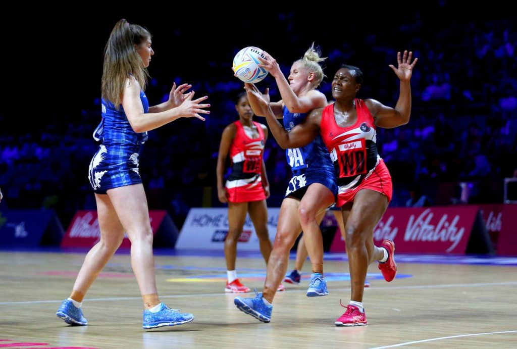 Scotland's Nicola McCleery, centre, and TT's Onella Jack in action during the Netball World Cup match in Liverpool, England, yesterday. via AP