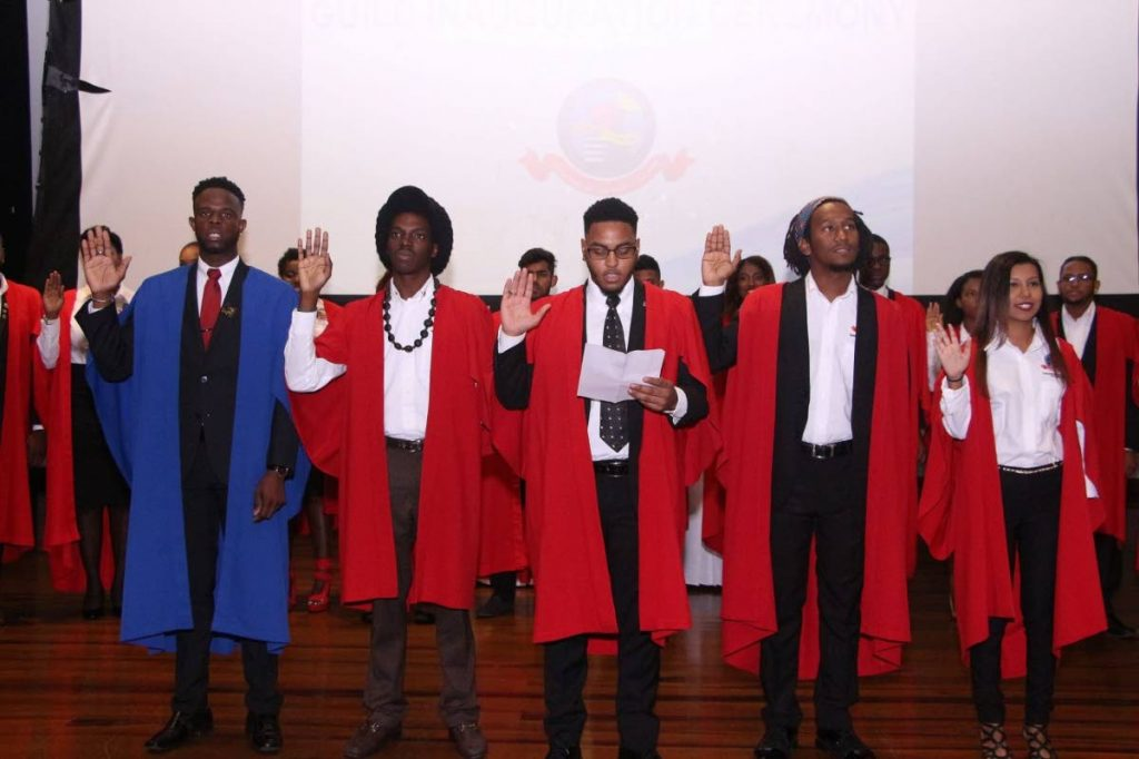 WE SWEAR: Guild president Justin Subero, centre,  at the swearing-in ceremony with  members of the executive, from left, Devon Harris, Nathanael John, Darweshi Gyton-Baptiste and Teshanna Mohammed. PHOTO COURTESY THE UWI