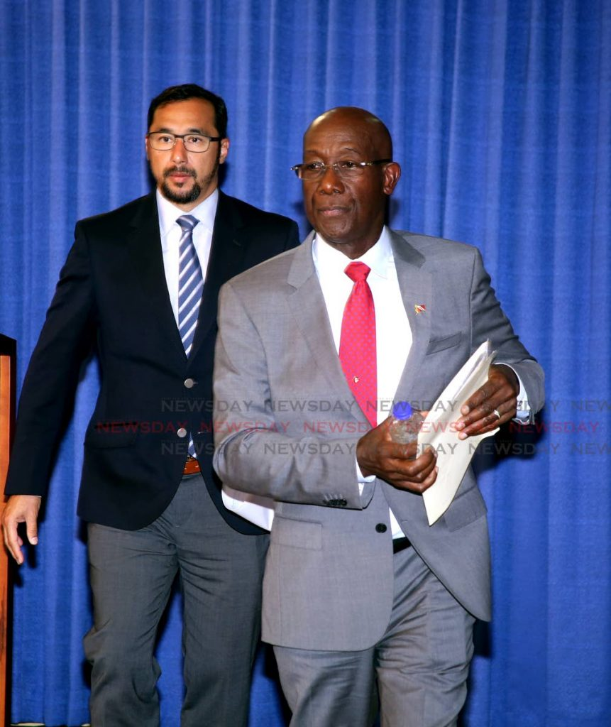 Prime Minister Dr Keith Rowley with National Security Minister Stuart Young at a post-Cabinet press briefing at the Diplomatic Centre in St Ann's, on Thursday. PHOTO BY SUREASH CHOLAI