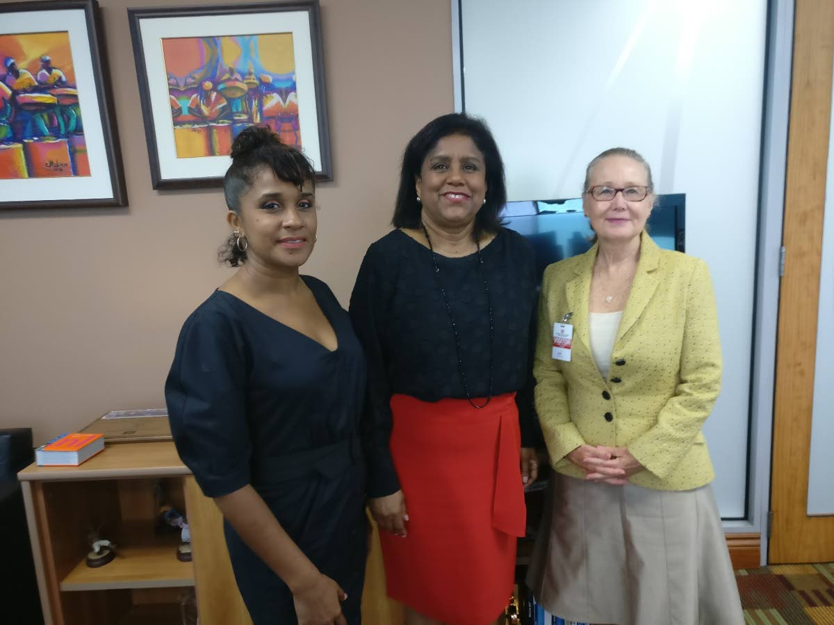 Trade Minister Paula Gopee-Scoon, centre, with Camille Selvon Abrahams, Animae Caribe founder, left, and  Joan Vogelesang, international animation consultant.