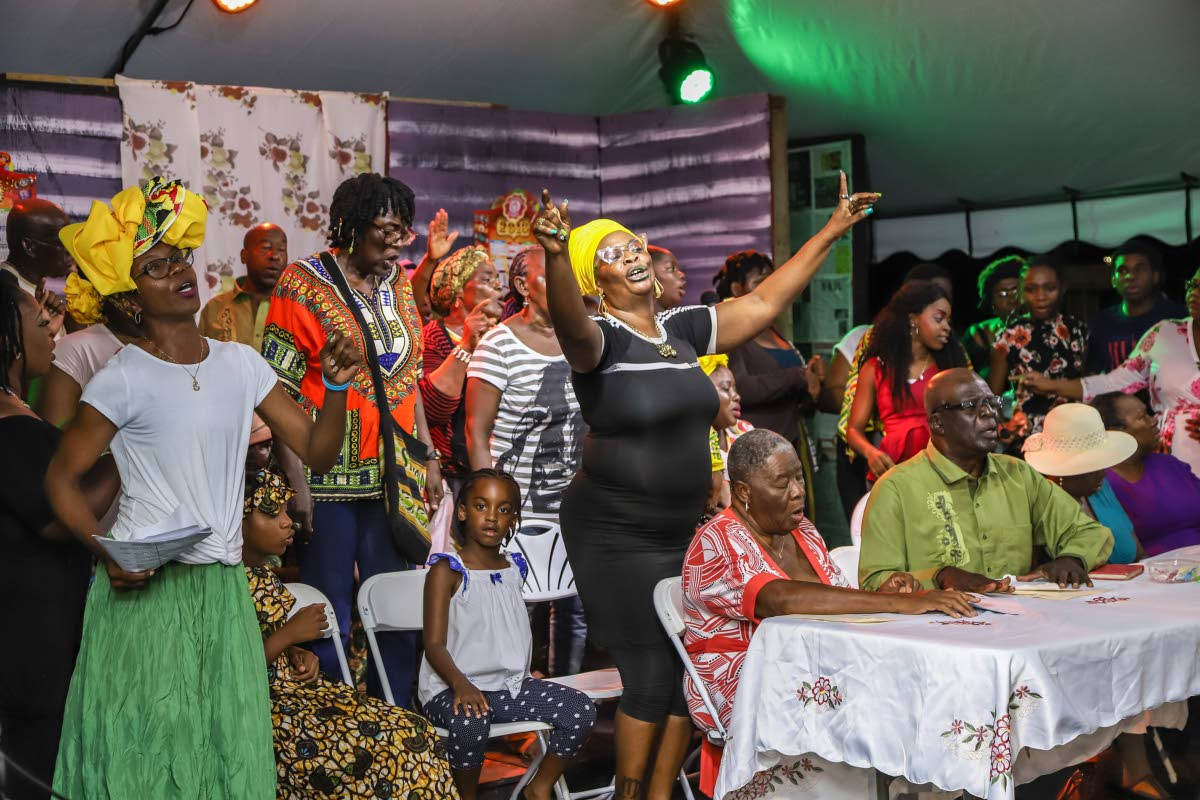An emotional scene from the Canaan/Bon Accord/Crown Point Wake and Bongo which is part of the Tobago Heritage Festival held on Wednesda.