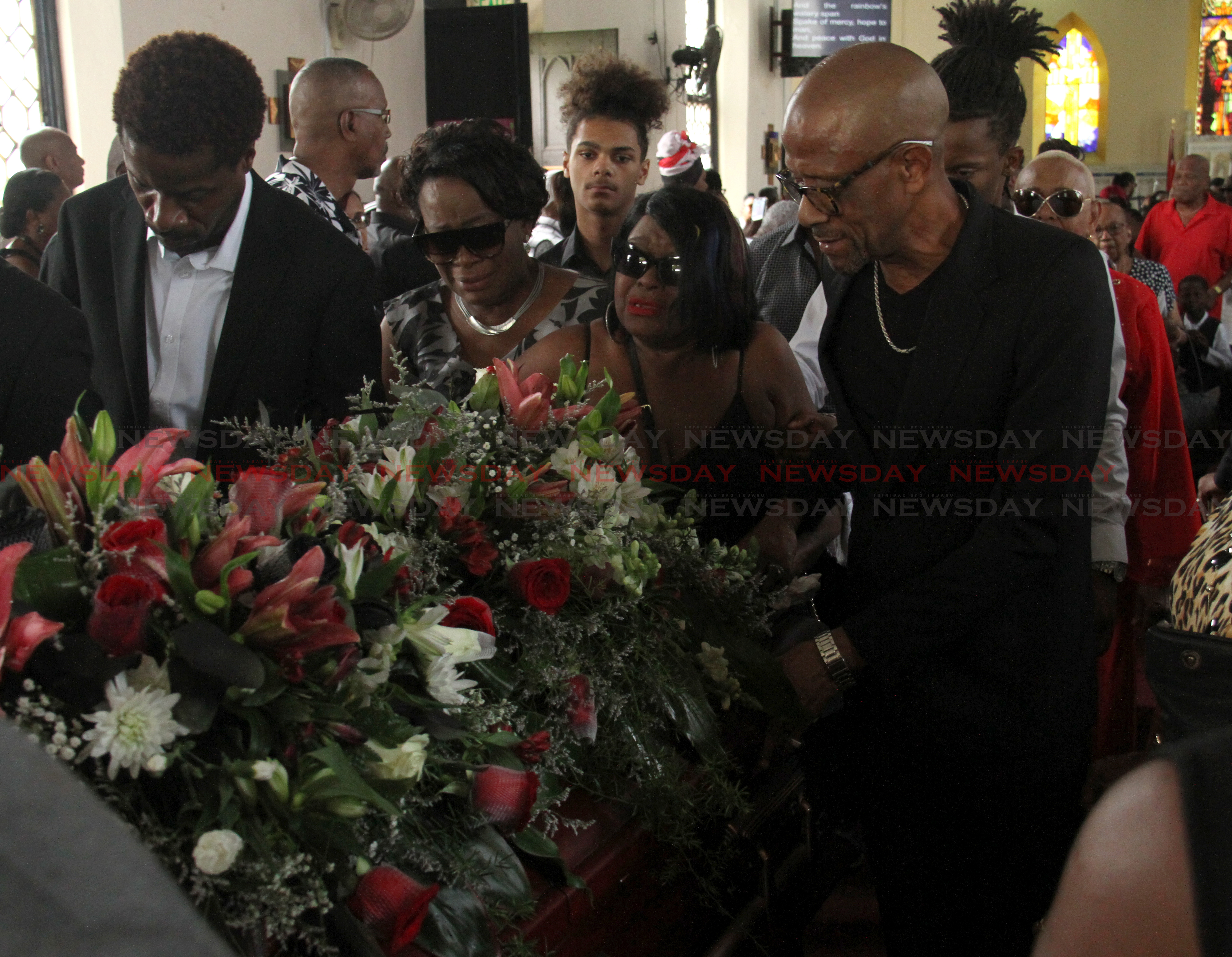 Family and friends of former TT mdoel Lystra Cudjoe at her funeral service which was held at the All Saints Anglican Church, Queen's Park Savannah West on Friday.  Photo: Ayanna Kinsale